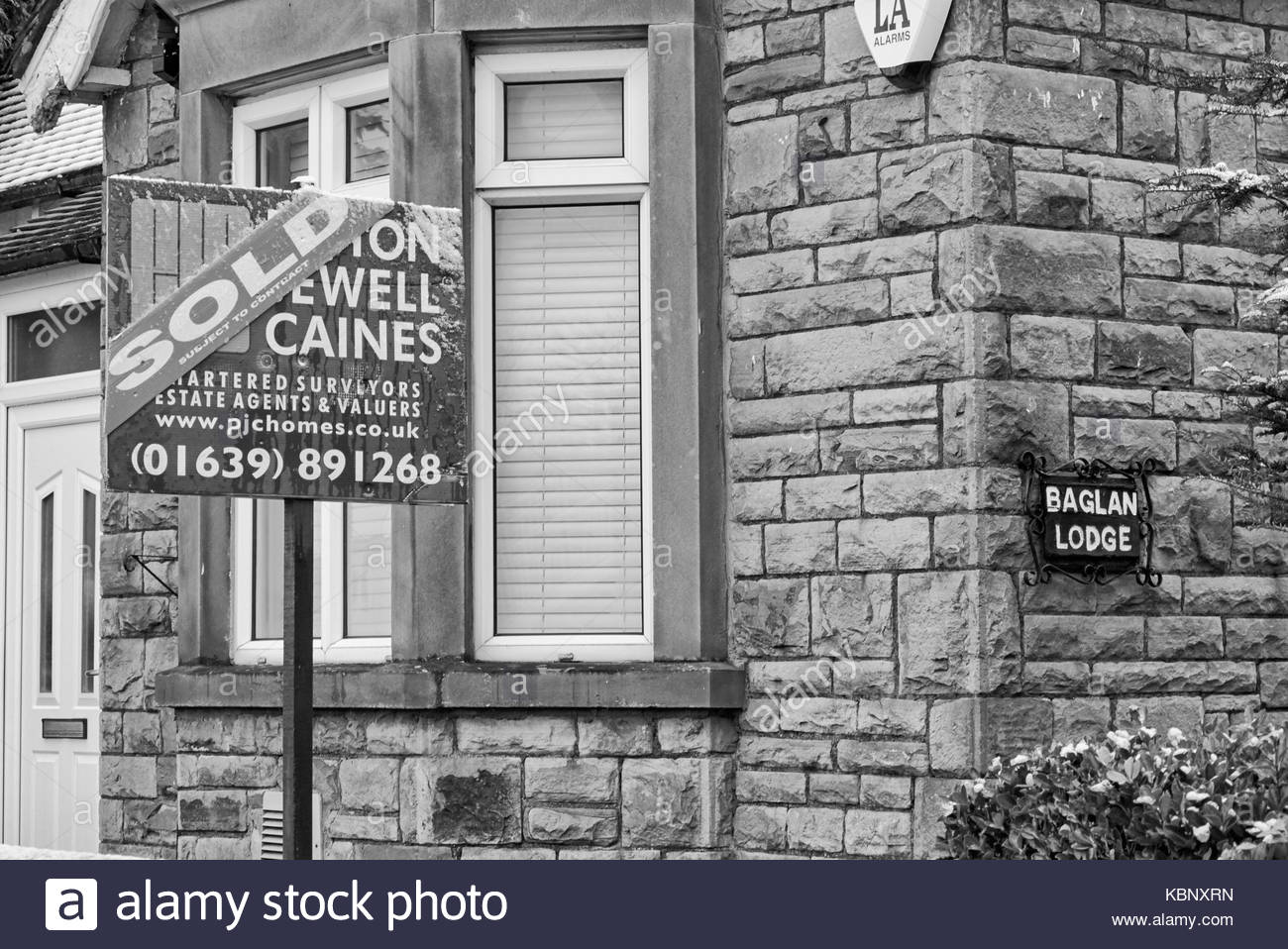 Baglan lodge stone cottage that has been sold near port talbot in south wales uk - Stock Image