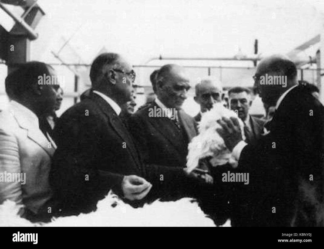 Atatürk (centre) accompanied by Bayar (to his left) and İnönü (to his right) at the Sümerbank - Stock Image