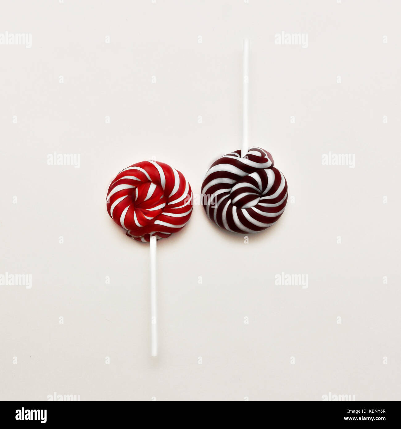 Lollipop Flat lay Minimal concept Two colored Lollipops are lying on white background Classic round red-white and - Stock Image