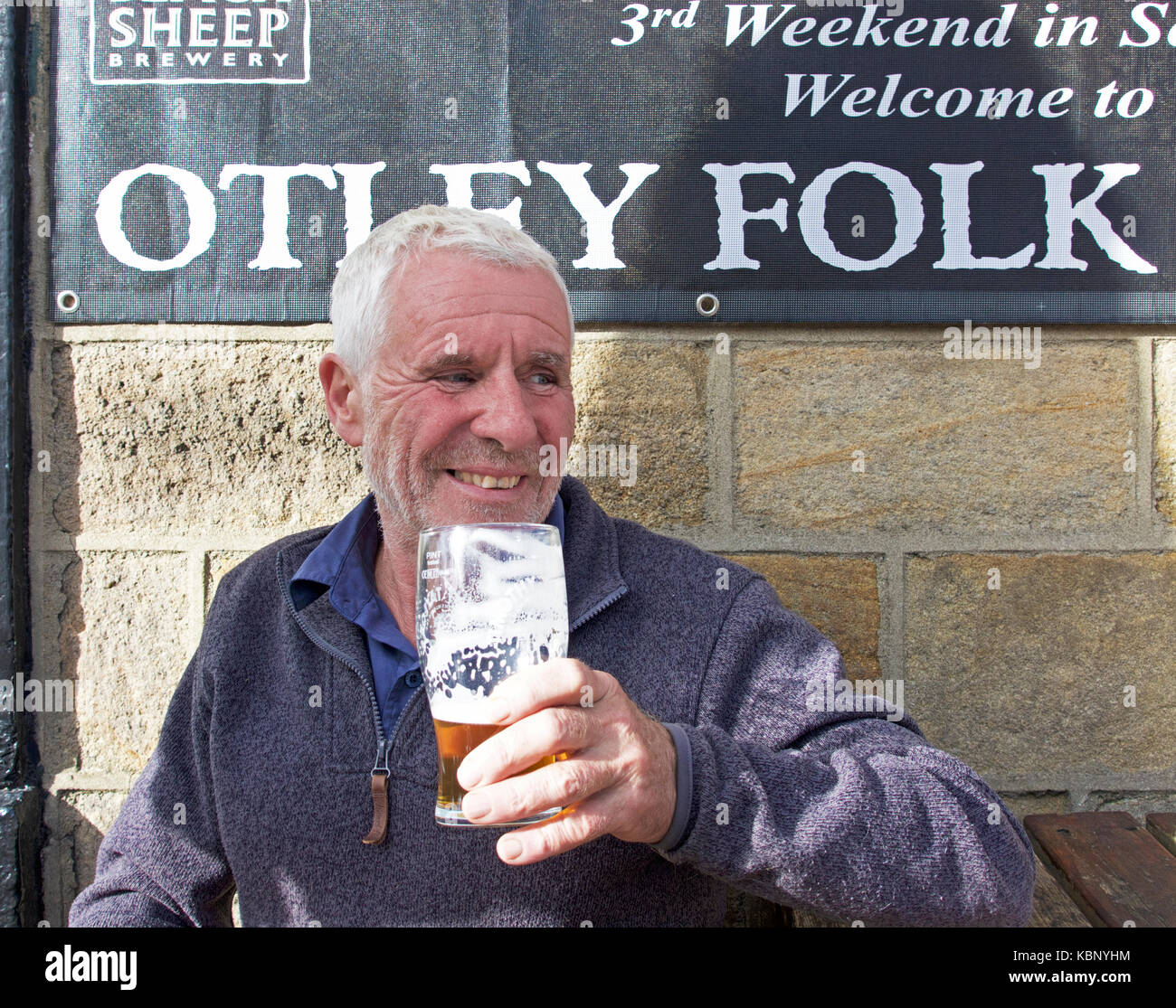 Senior man drinking beer at Otley Folk Festival, West Yorkshire, England UK - Stock Image