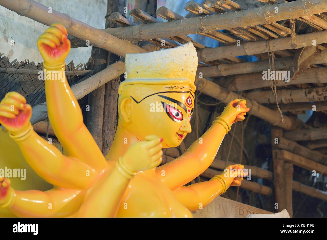 Clay idol of Goddess Durga under preparation for Durga Puja festival in India - Stock Image