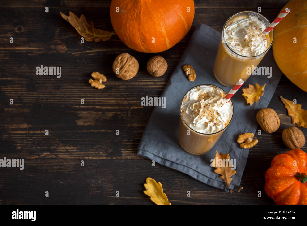 Pumpkin Smoothie. Fresh Pumpkin and Apple Smoothie or Milkshake with Walnuts and Autumn Spices. Seasonal Autumn - Stock Image