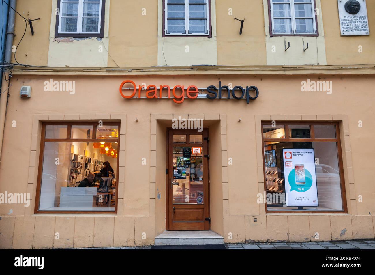 SIBIU, ROMANIA SEPTEMBER 22, 2017: Orange logo in an Orange Shop. Orange S.A., formerly France Telecom S.A., is - Stock Image