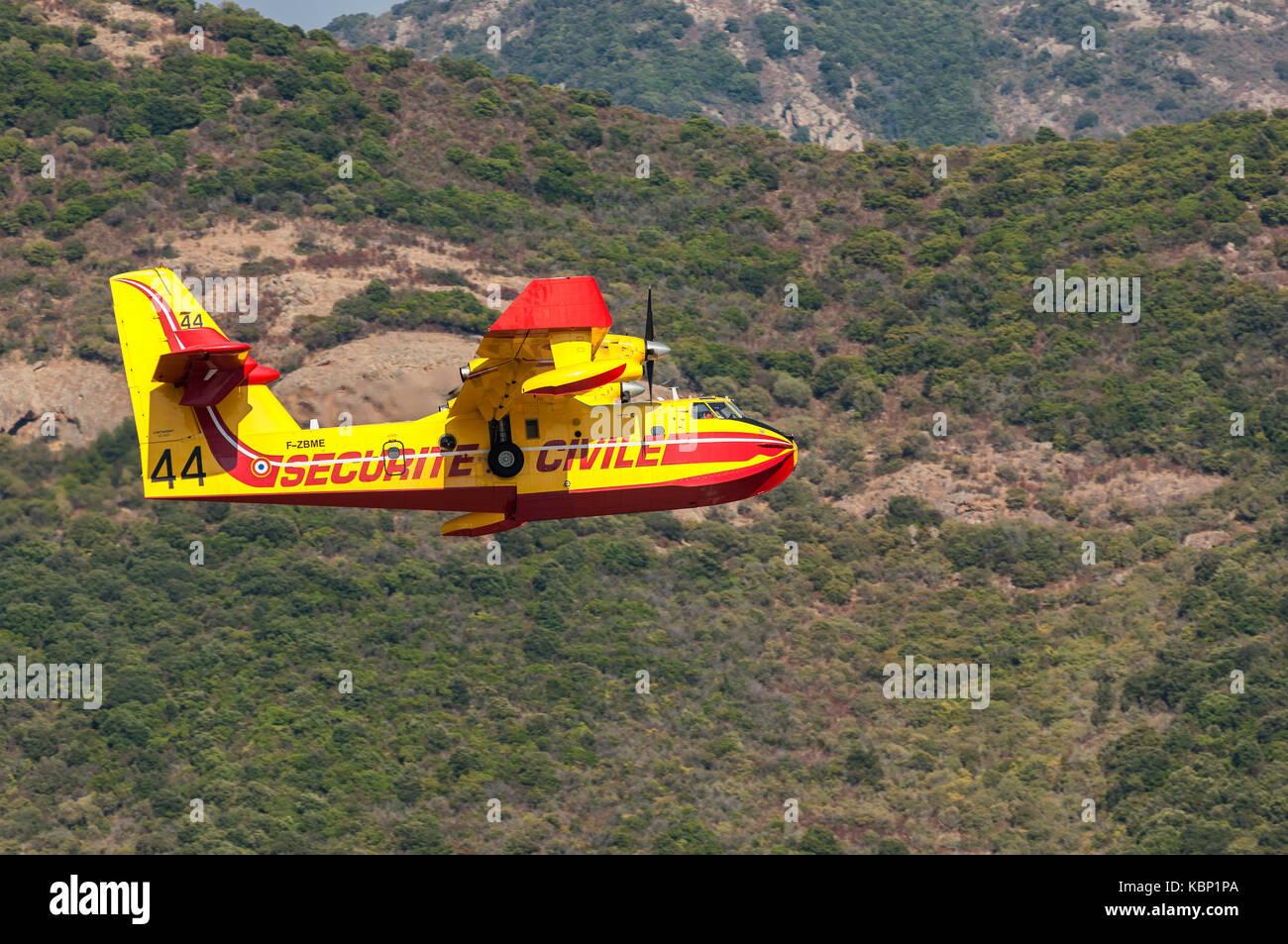 Canadair en Vol Plage de Sagone Haute Corse France 2B - Stock Image