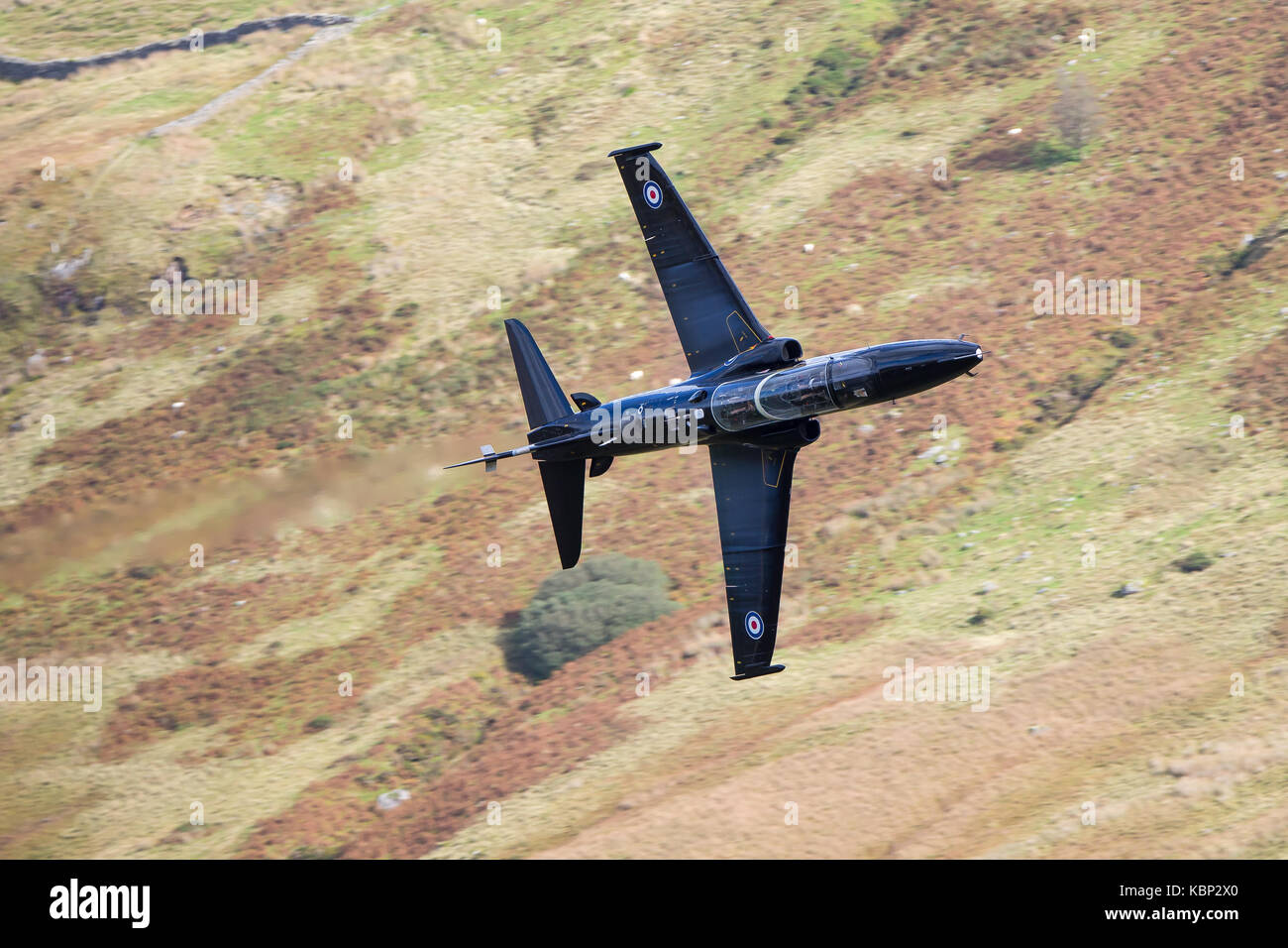 Hawk aircraft low flying through the hillside. Mid-Wales, UK. - Stock Image