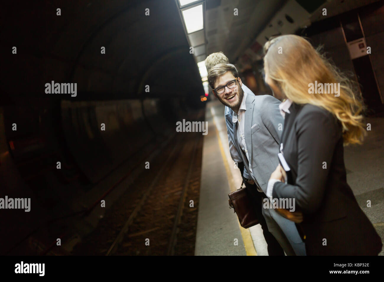 Business people waiting for subway - Stock Image