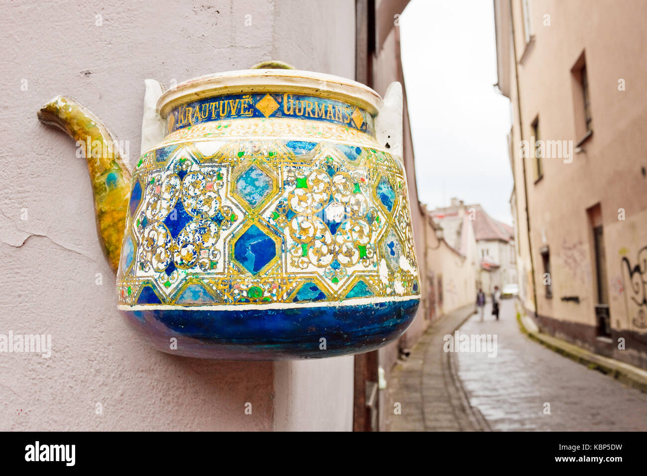 Vilnius, Lithuania - September 15, 2015: Colorful tea pot on a building wall in the old town of Vilnius. - Stock Image