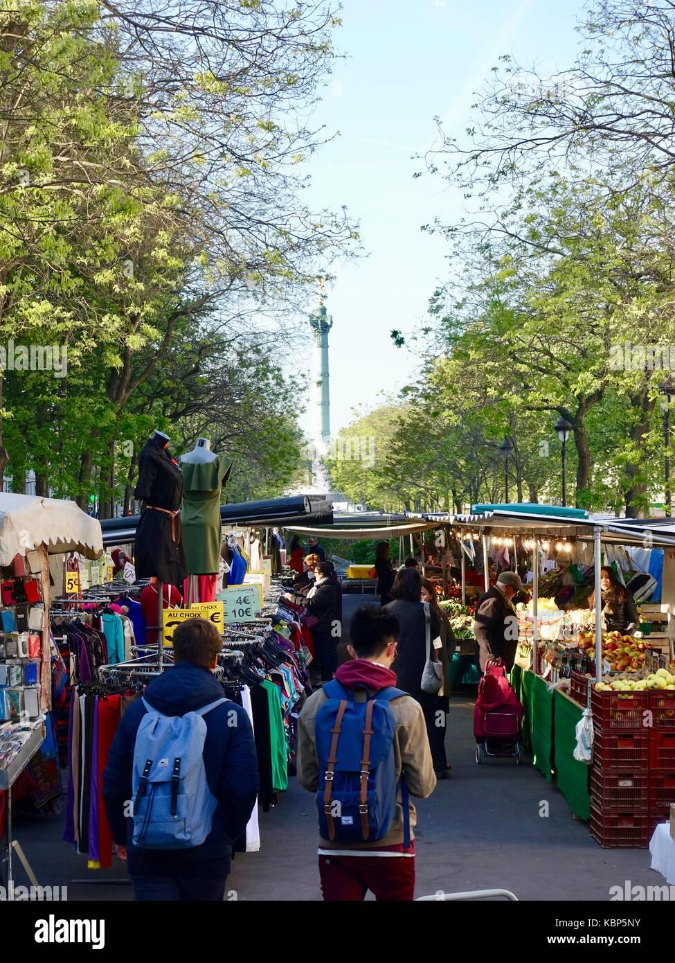 School boys with backpacks walking into Thursday morning Bastille Market. Blvd Richard Lenoir, 11th Arrondissement, - Stock Image