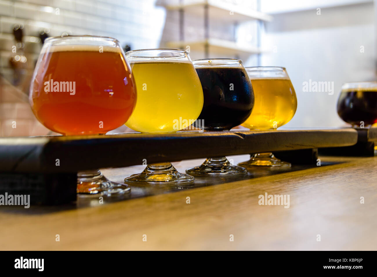Craft beer tasting in Tijuana, Mexico after an evening of photography. - Stock Image