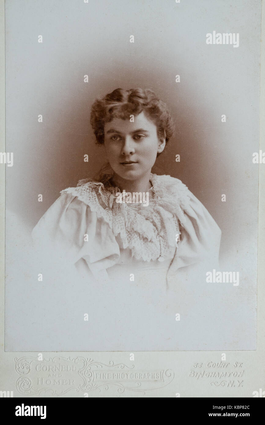 American archive monochrome studio portrait photograph of a young woman with thoughtful gaze wearing a light coloured - Stock Image