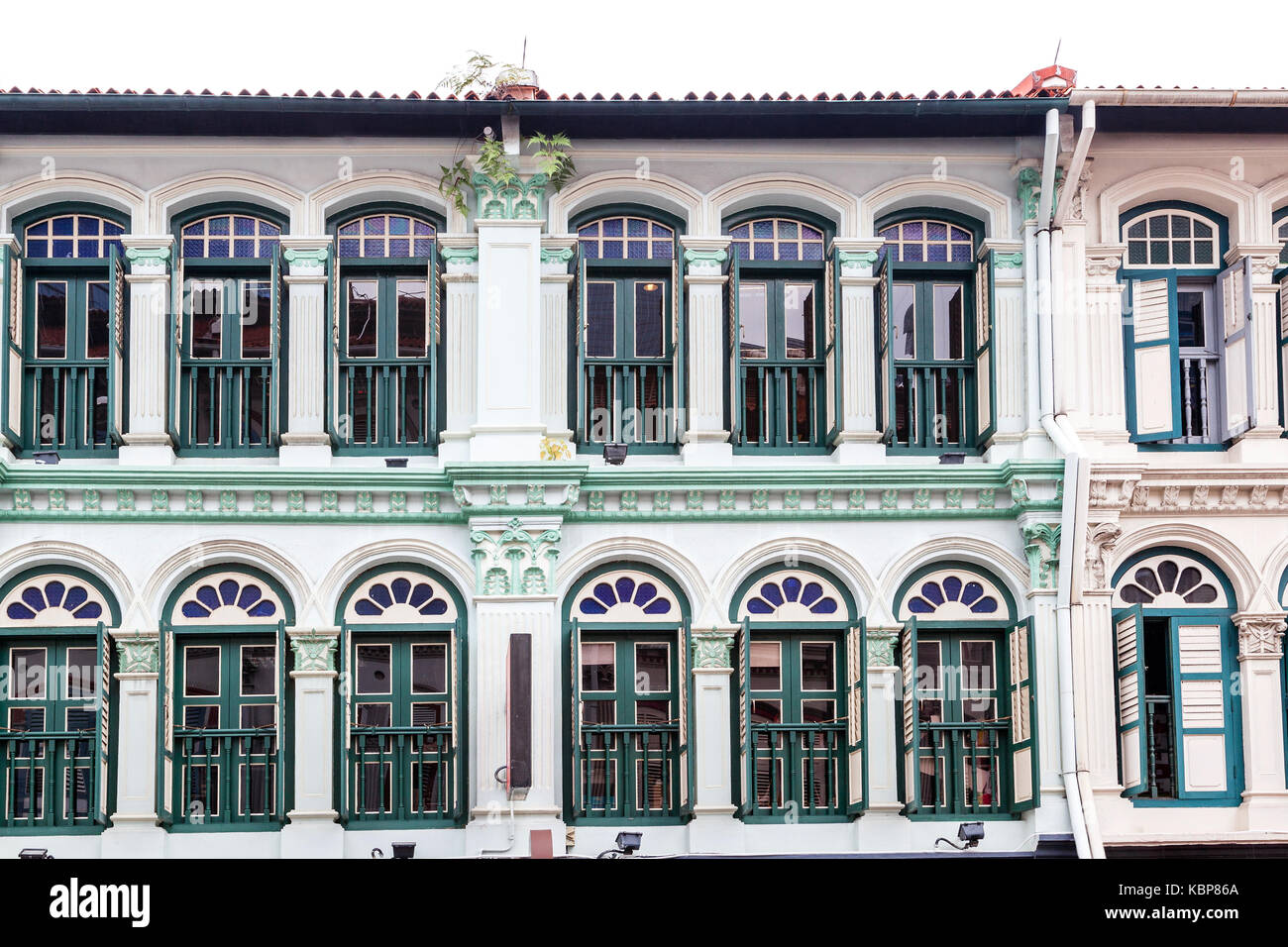 Rows of colonial style shophouses seen at Tanjong Pagar near Chinatown in Singapore. These charming narrow units - Stock Image