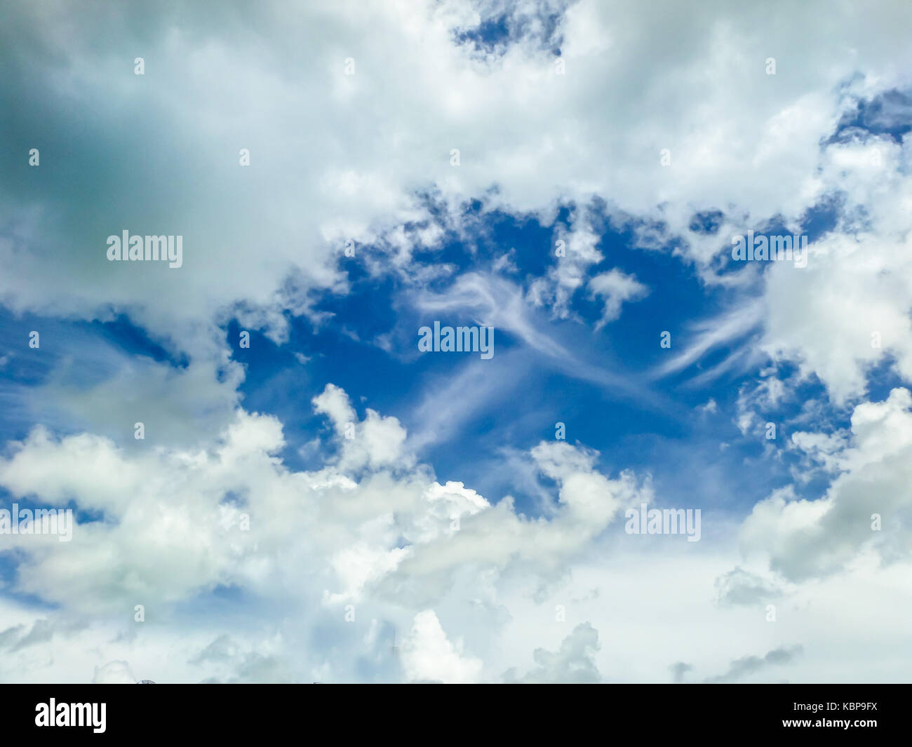 clound blue sky background at midday in spring - Stock Image