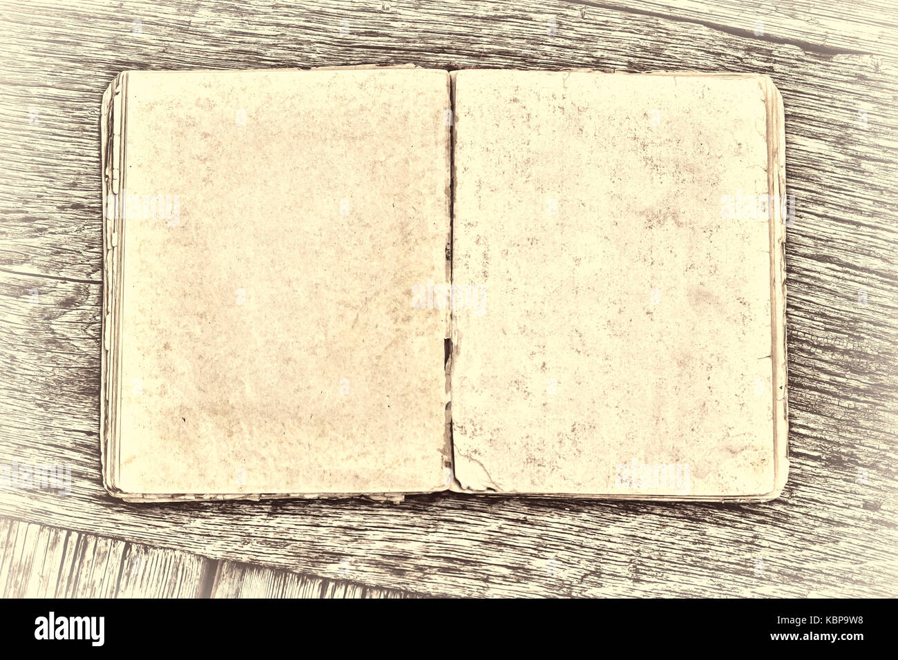 An old book on a wooden table. Country style Stock Photo