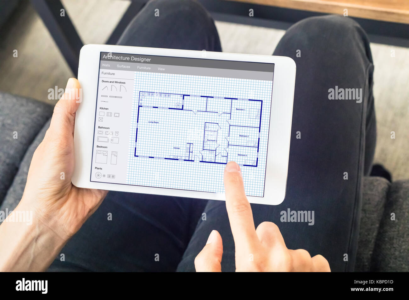 Person sketching a home design architecture project on a digital person sketching a home design architecture project on a digital tablet computer app showing a blueprint floor plan drawing malvernweather Choice Image