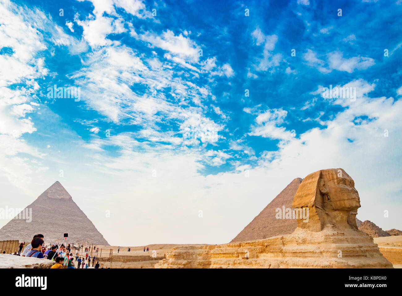 Admiring the sphinx in Cairo, Egypt - Stock Image
