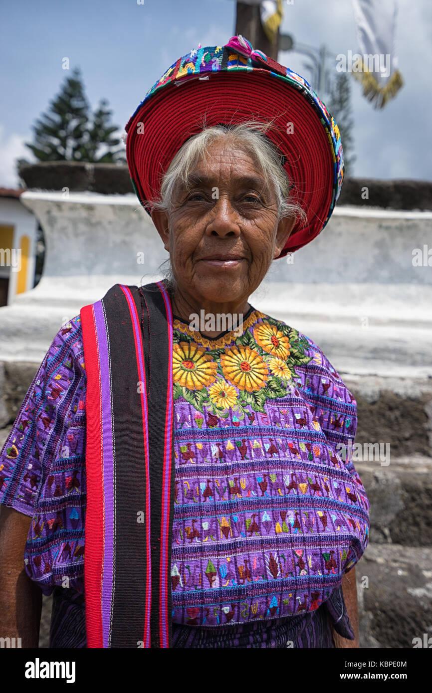 April 30, 2016 Santiago de Atitlan, Guatemala: elderly mayan woman in colourful traditional dress and hat - Stock Image