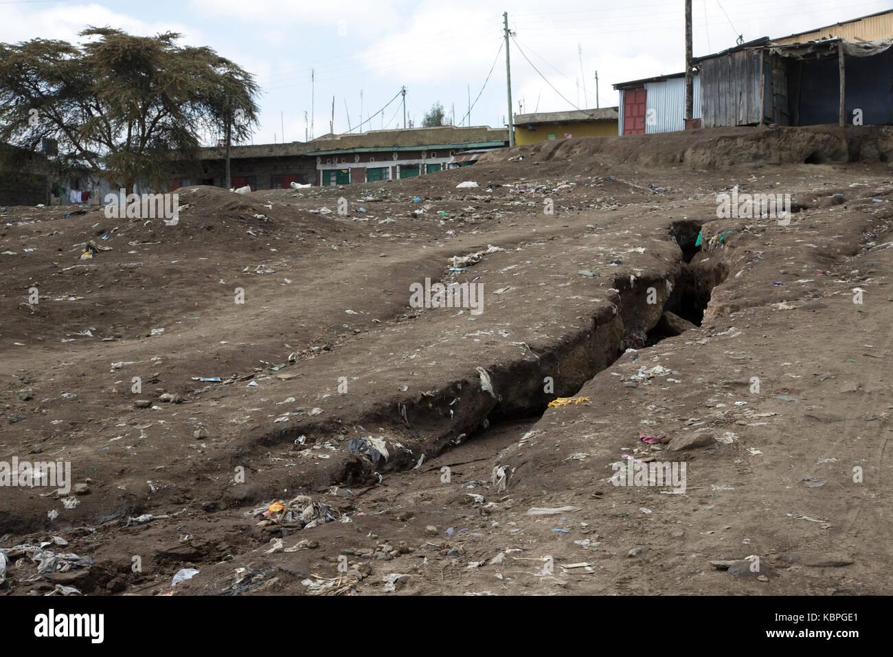 Erosion gully developing outside Kamere Township Kenya - Stock Image