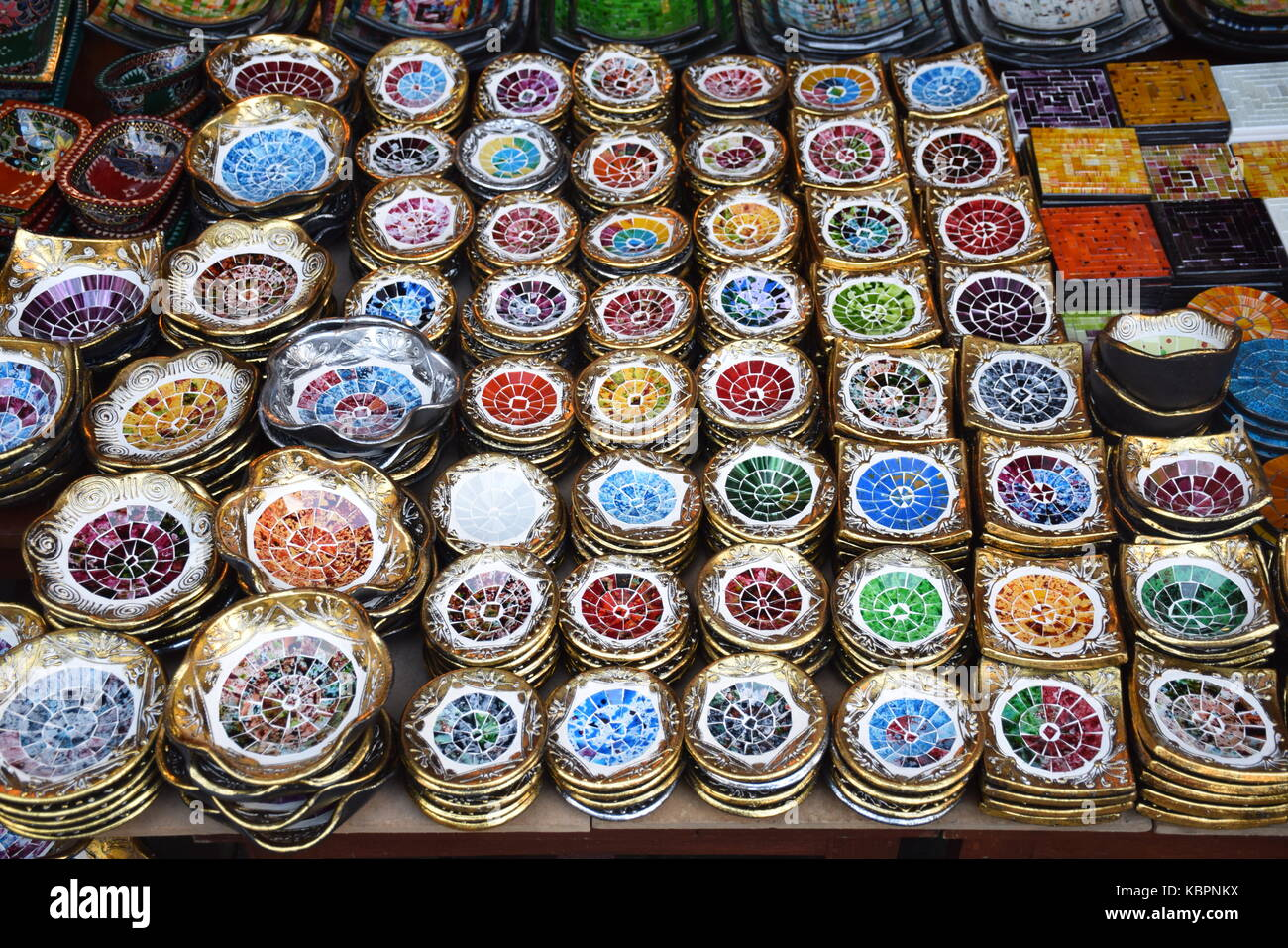 Colorful small plates sold in a shop in Ubud market in Bali, Indonesia - Stock Image