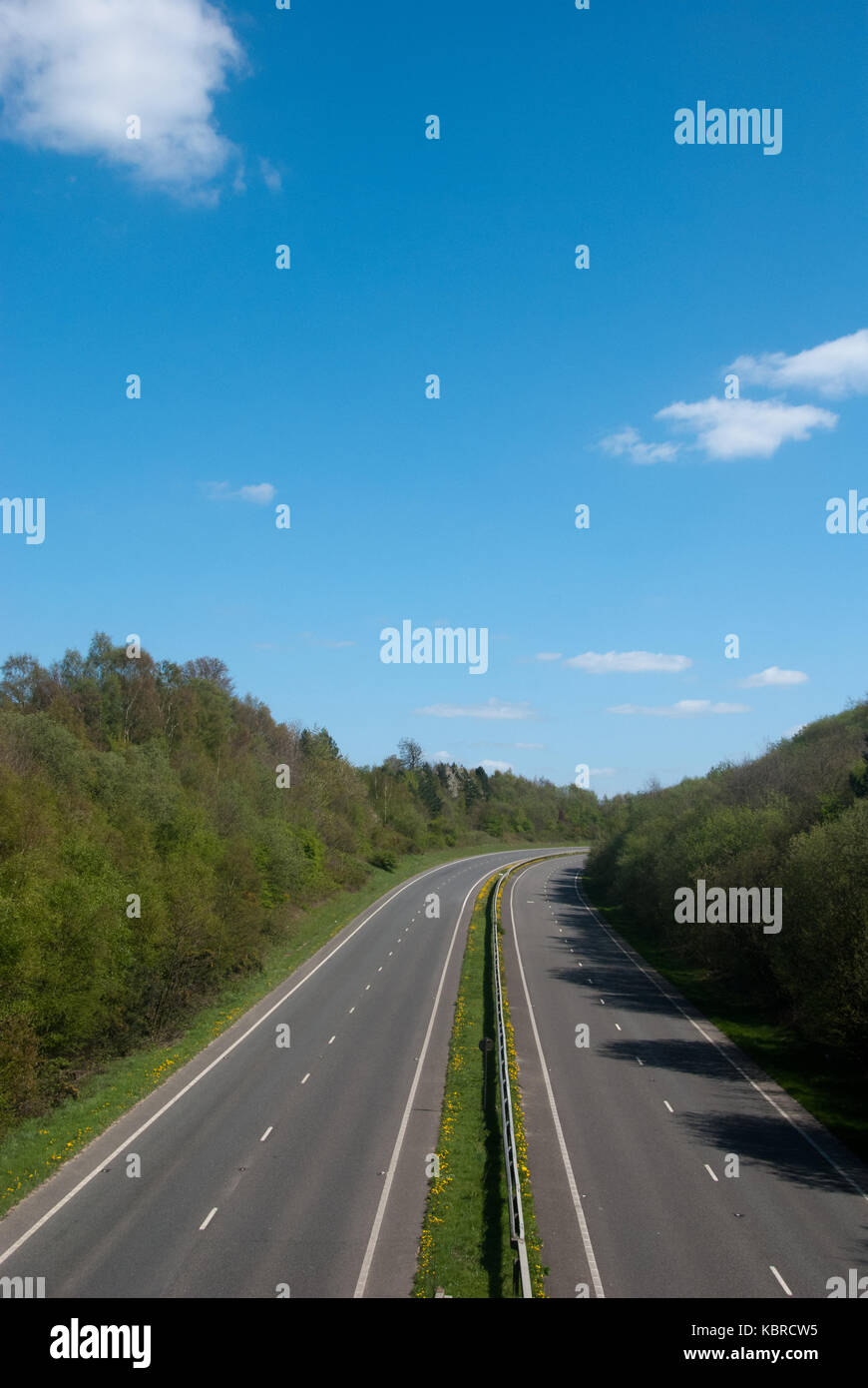 A view from a bridge looking along n English motorway with no traffic Stock Photo