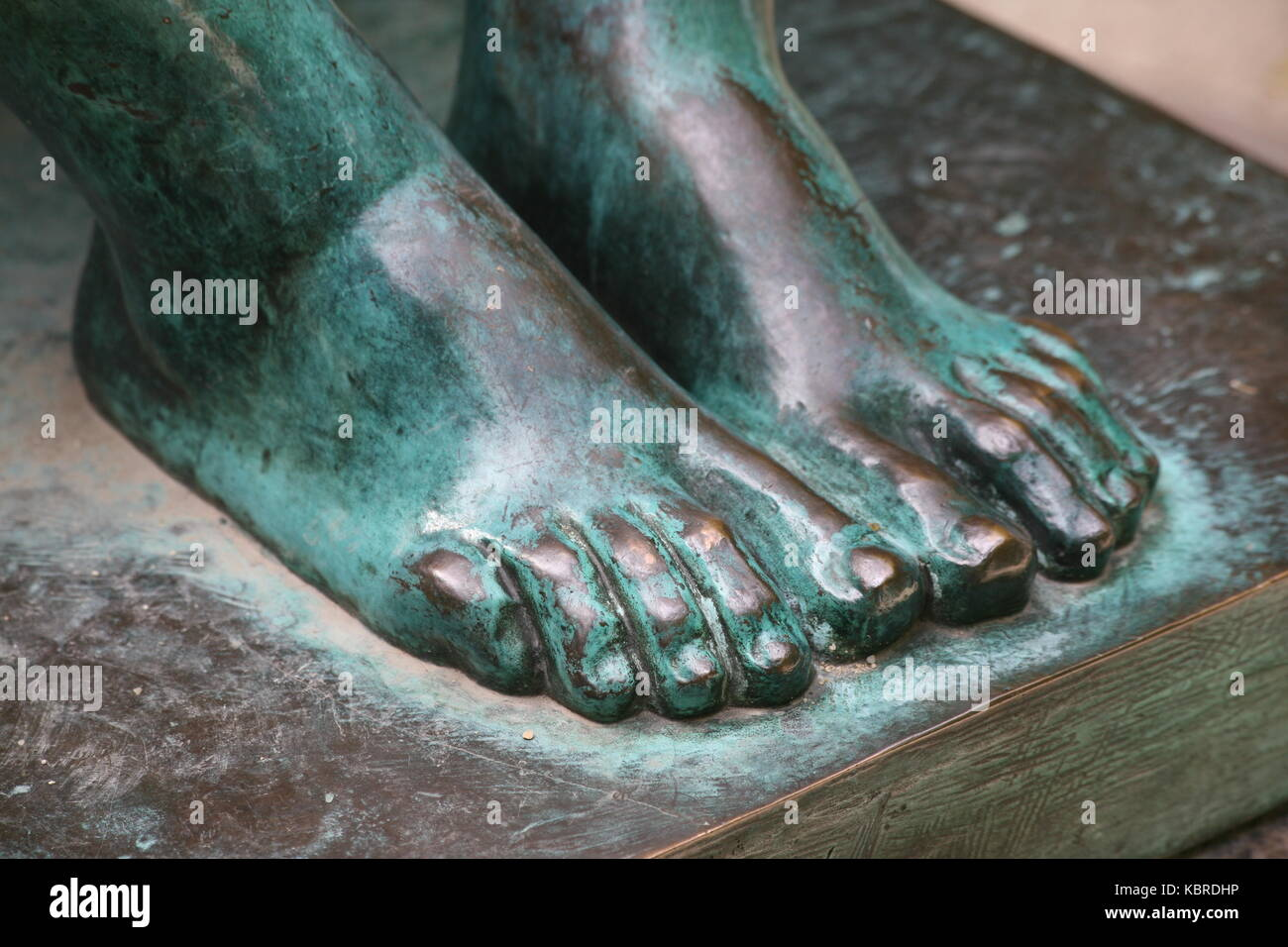 Füsse aus Bronze -  Feet made of bronze - Stock Image