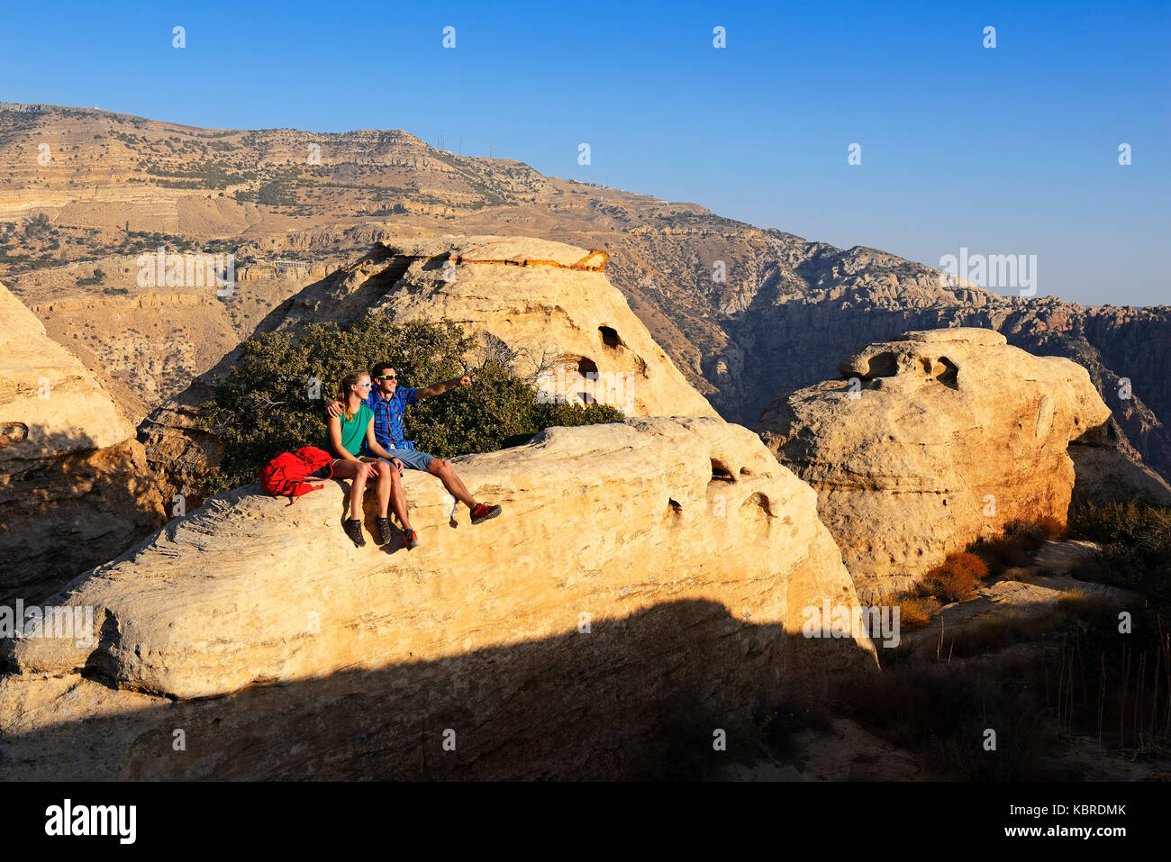 Hikers at White Domes Trail, Dana Biosphere Reserve, Dana, Jordan - Stock Image