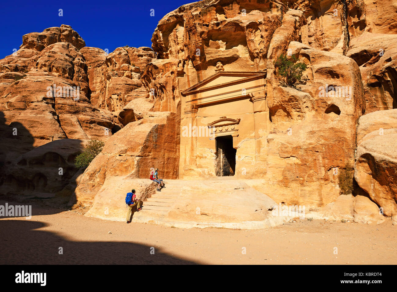 Hikers at rock-church in Little Petra, Jordan - Stock Image