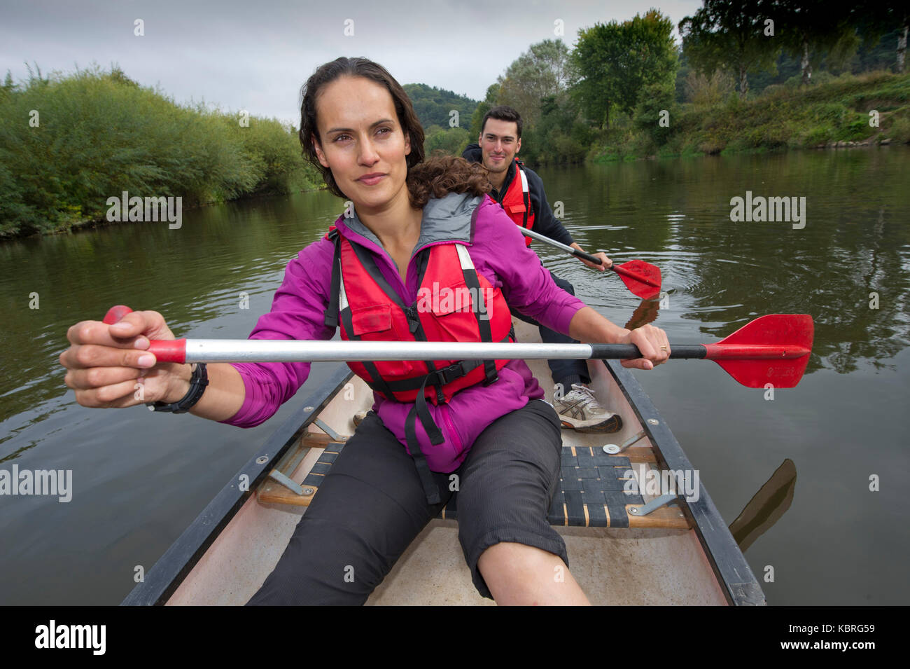 Broadcaster, model, anthropologist Mary-Ann Ochota canoing with her husband Joe Craig on the River Severn with their Stock Photo