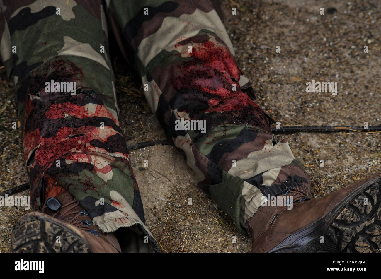 Realistic making-up simulates war injuries on walkers on legs, Bron, France - Stock Image