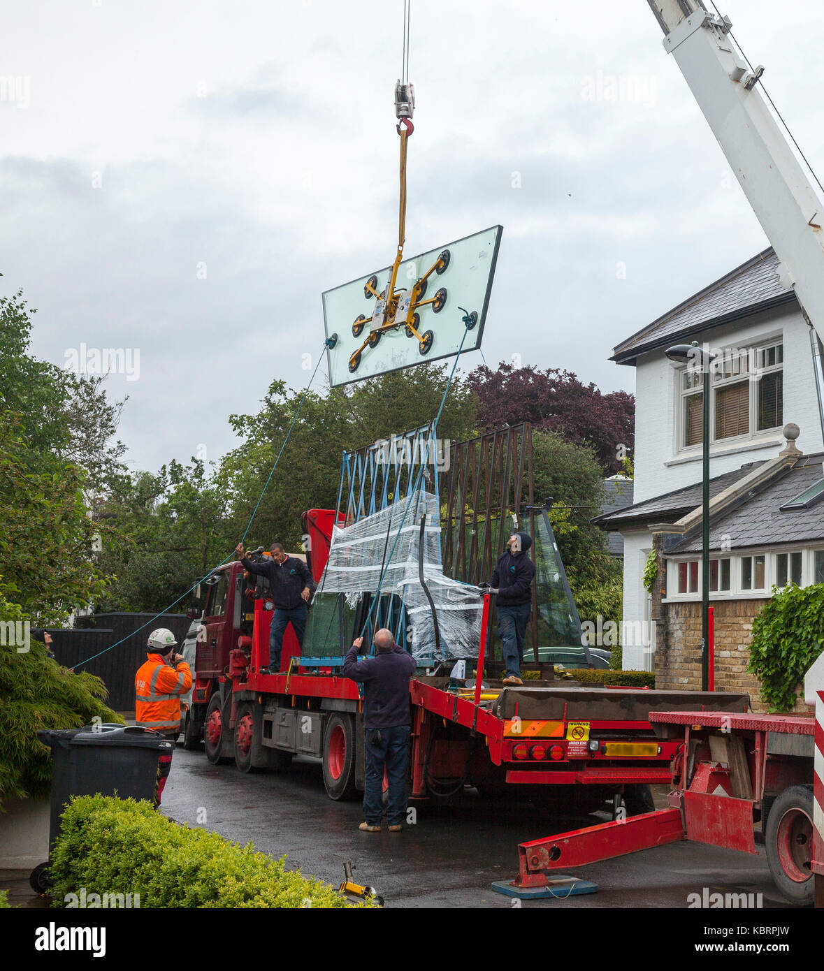 installing large glass panels into a conservatory roof. - Stock Image