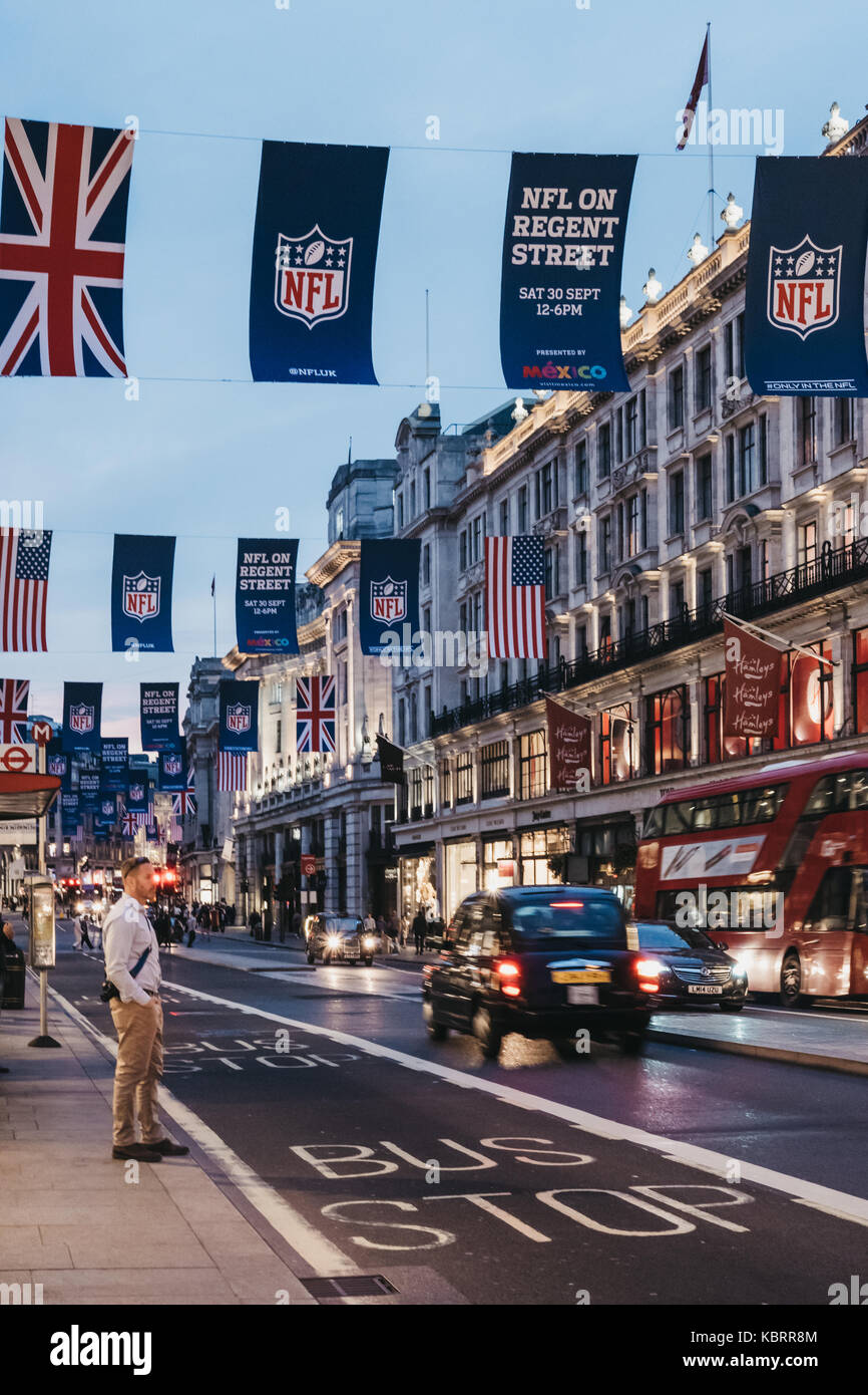 Black taxi and red bus on Regent Street, London. The street is decorated with NFL flags to celebrate the event and - Stock Image
