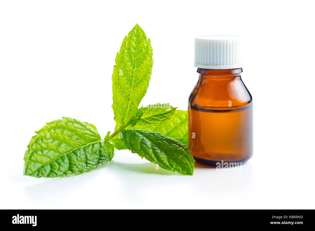 Bottle of essential mint oil isolated on white background. - Stock Image