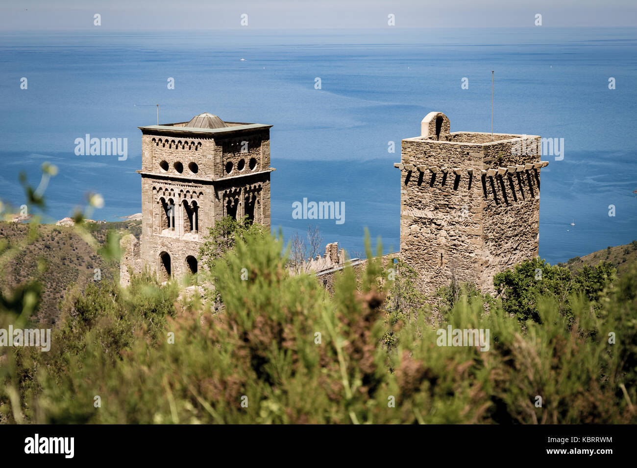 Bushes on the foreground and monastery of Sant Pere de Rodes in back Stock Photo