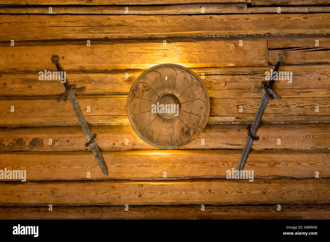 Two medieval sword and shield on wall Stock Photo