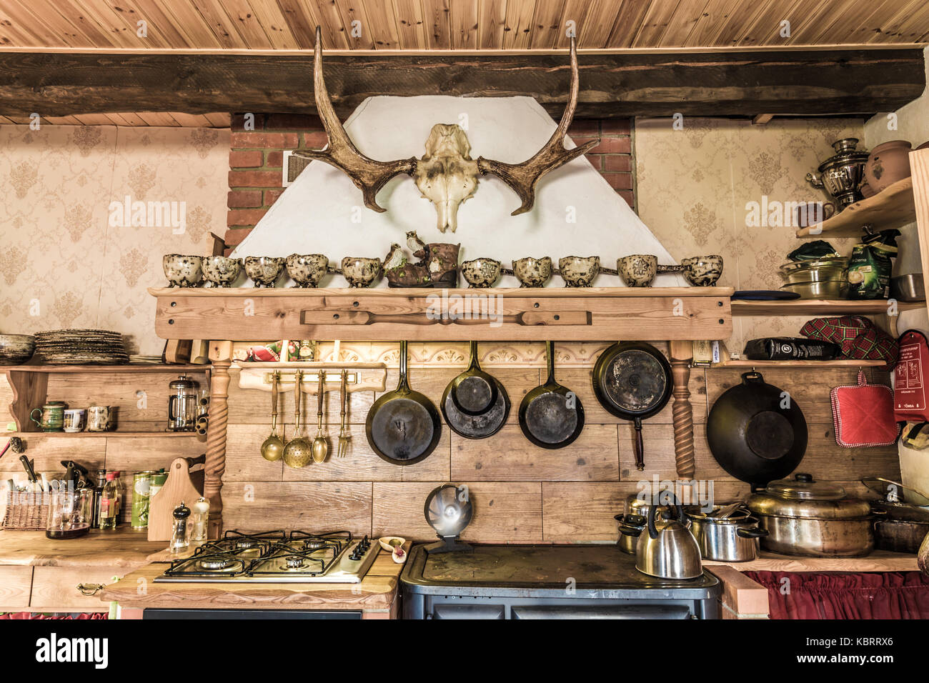 Rustic style kitchen with pots and pans Stock Photo