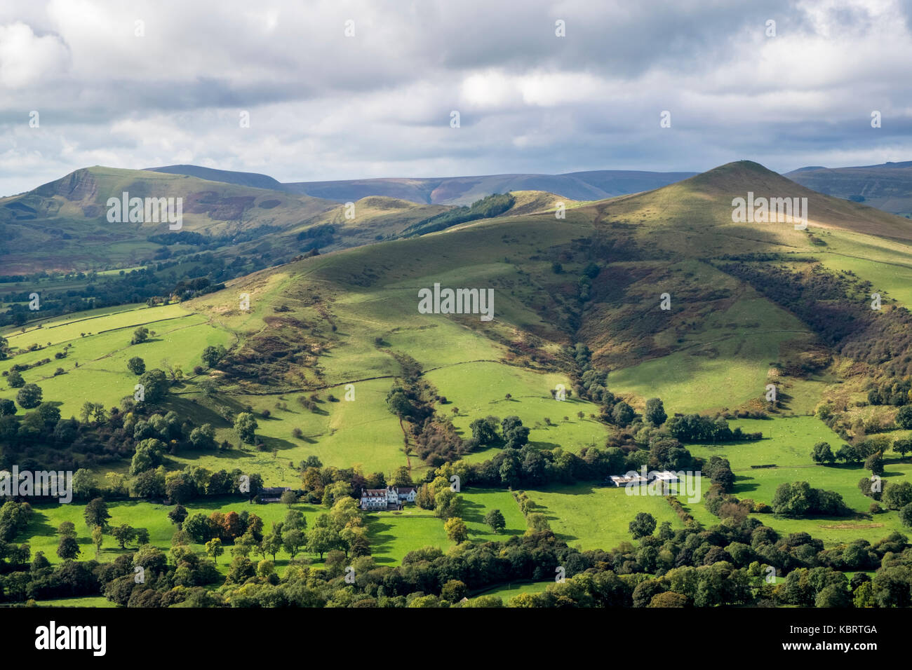 Derbyshire landscape. Lose Hill and the Great Ridge in Autumn sunshine breaking through dark moody clouds, Derbyshire, - Stock Image