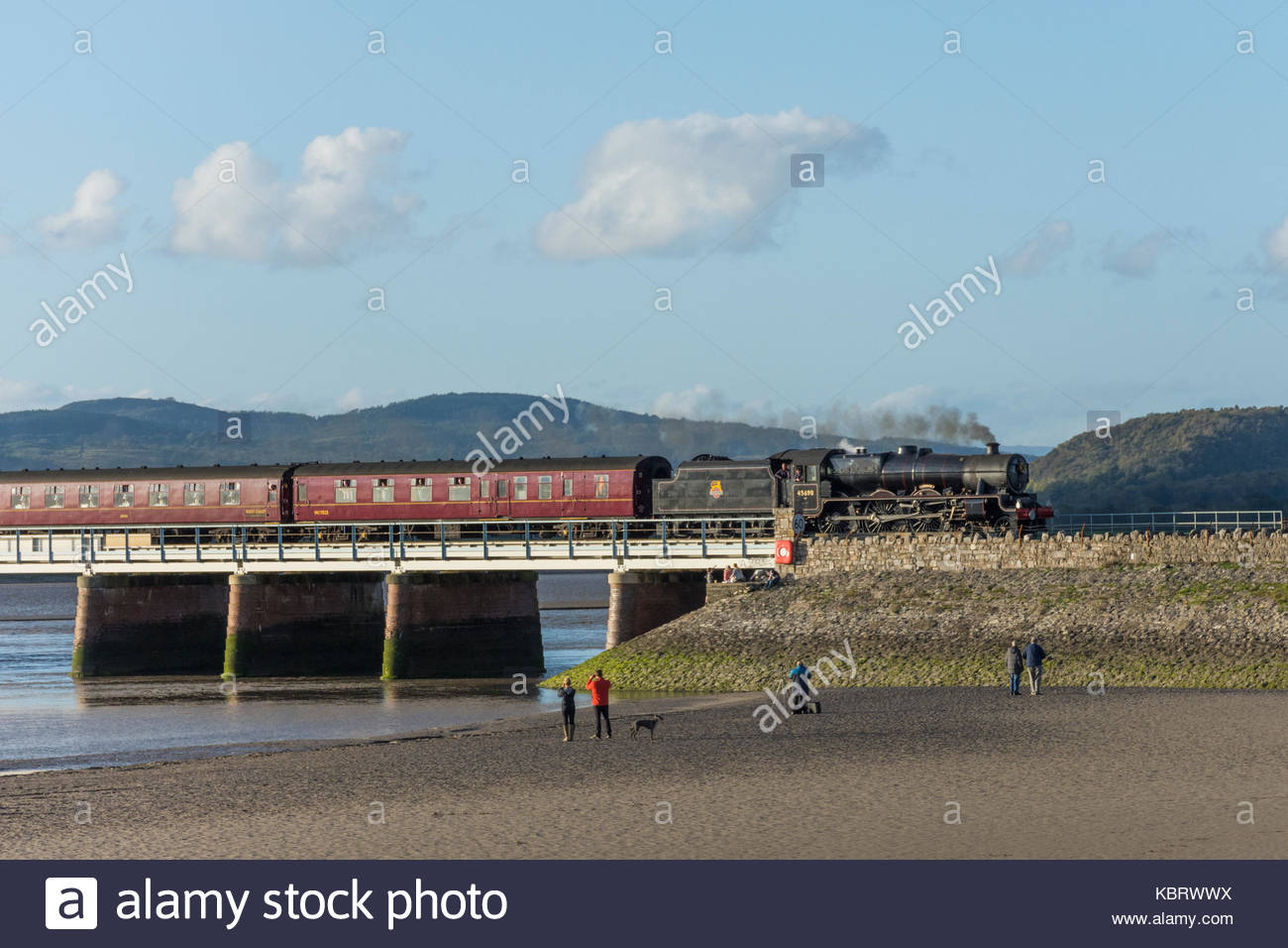 Arnside, Cumbria, UK, 30 September 2017, the evening light illuminates the 45690, 'Leander' locomotive, - Stock Image