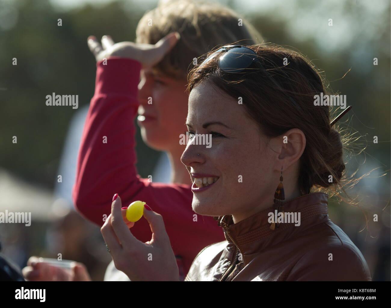 Crimea, Russia. 30th Sep, 2017. People attend the WineFest grape harvesting and wine making festival at the Zolotaya Balka winery in the city of Balaklava. Credit: Sergei Malgavko/TASS/Alamy Live News Stock Photo