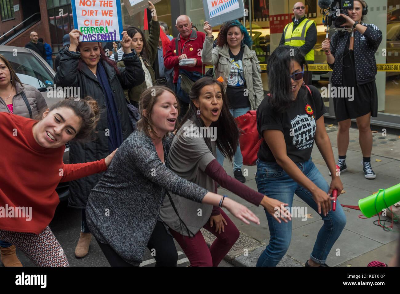 September 30, 2017 - London, UK. 30th September 2017. Protesters dance outside the Ferrari showroom of Kensington - Stock Image