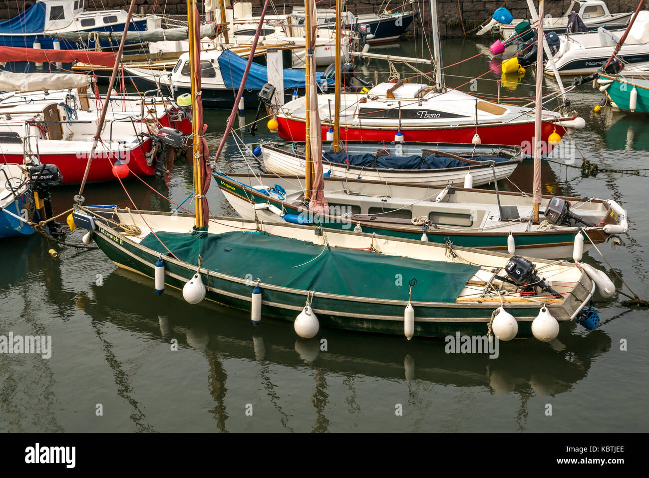 Close up of sailing boats in North Berwick harbour and water reflections, East Lothian, Scotland, UK - Stock Image