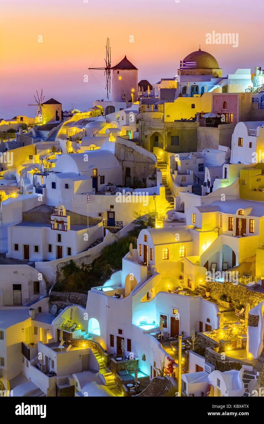 Aerial view of  Oia town, Santorini island, Greece at sunset. Traditional and famous white houses and churches  - Stock Image