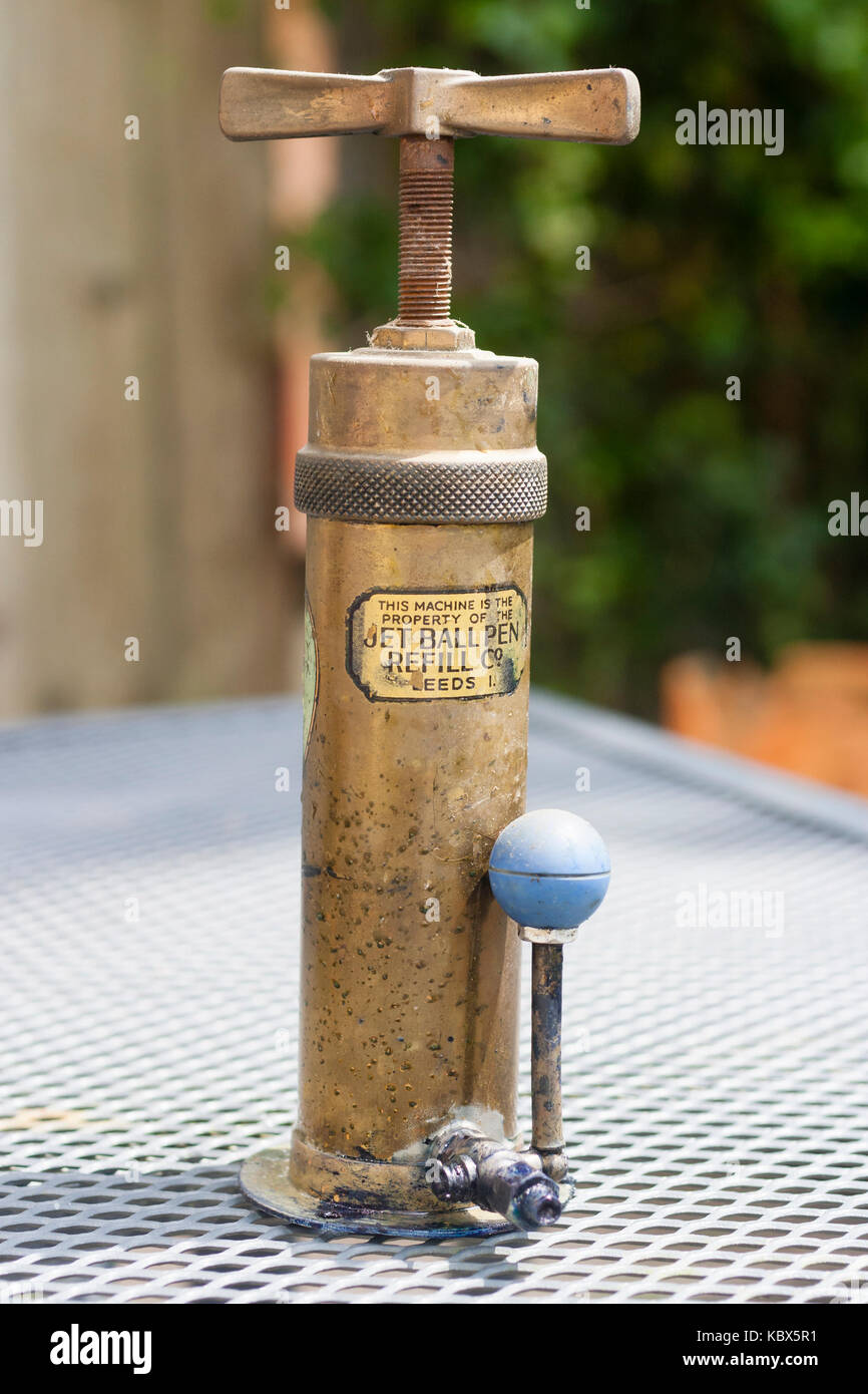 Antique brass ink dispenser used for refilling ball pens and manufactured by the Jet Ball Pen Refill Co - Stock Image