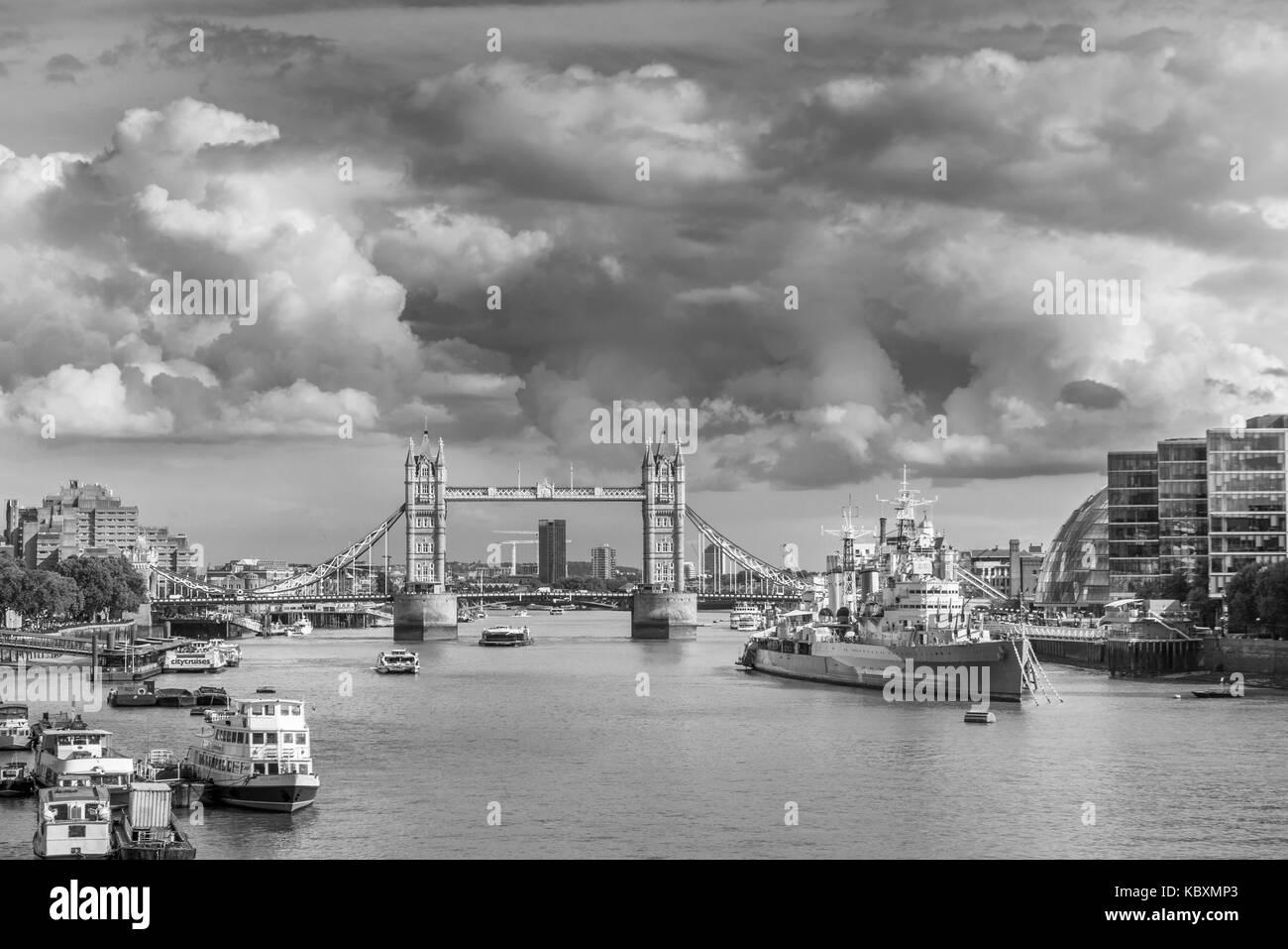 Iconic London sights: panorama along River Thames at the Pool of London and Docklands by Tower Bridge and HMS Belfast, - Stock Image