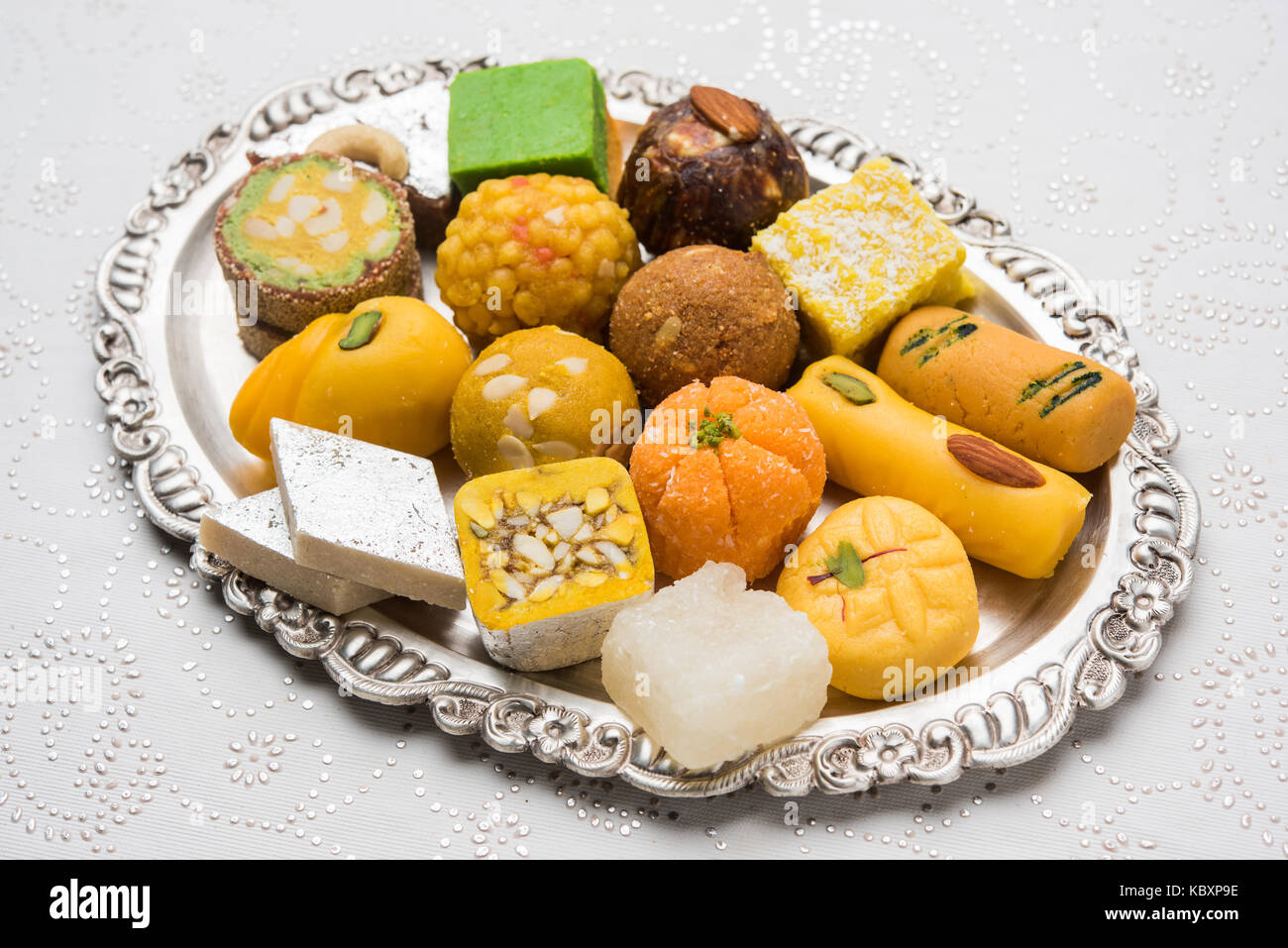 Stock Photo Of Indian Sweets Served In Silver Or Wooden Plate Stock Photo Alamy