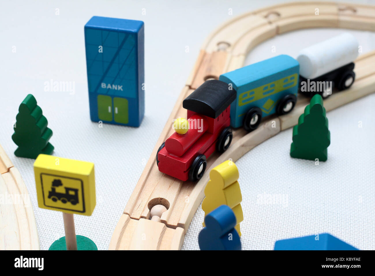 wooden toy city in white background - Stock Image