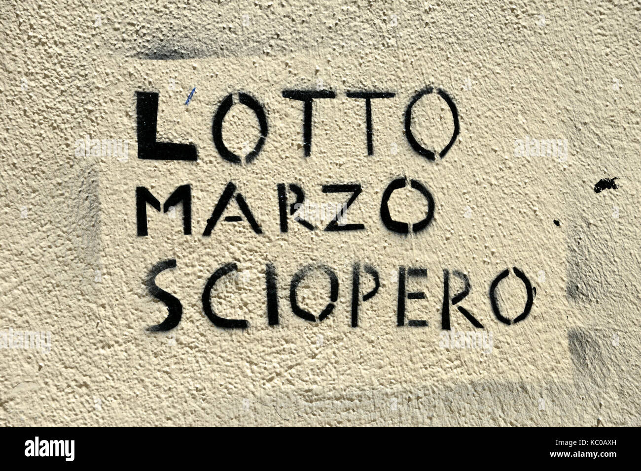 slogan written on a wall about the recurrence of March 8th - Stock Image