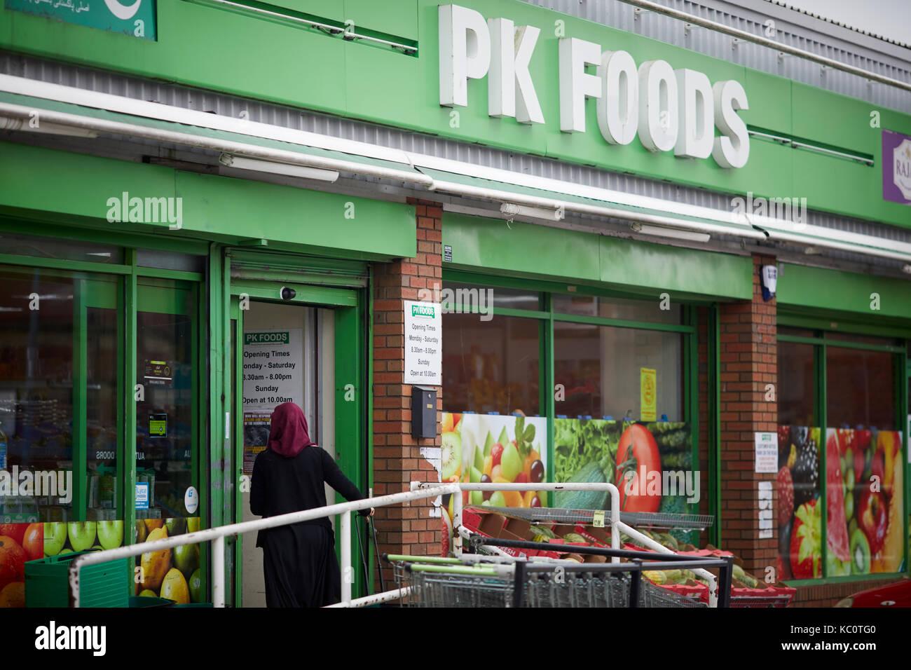 PK Foods supermarket in Bolton on Blackburn Road - Stock Image