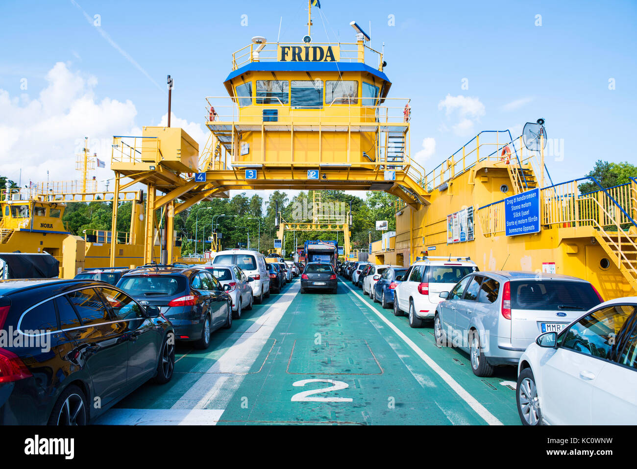 Aboard the car and passenger ferry, Frida, between Yxlan and Furusund in the Stockholm archipelago in Sweden - Stock Image