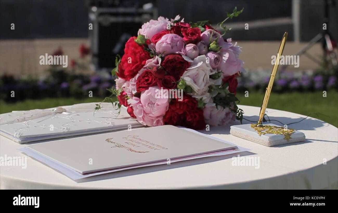 Decoration of wedding arch with registration table for newlyweds sunshine illuminates registration book standing on white table decorated with pink flowers mightylinksfo