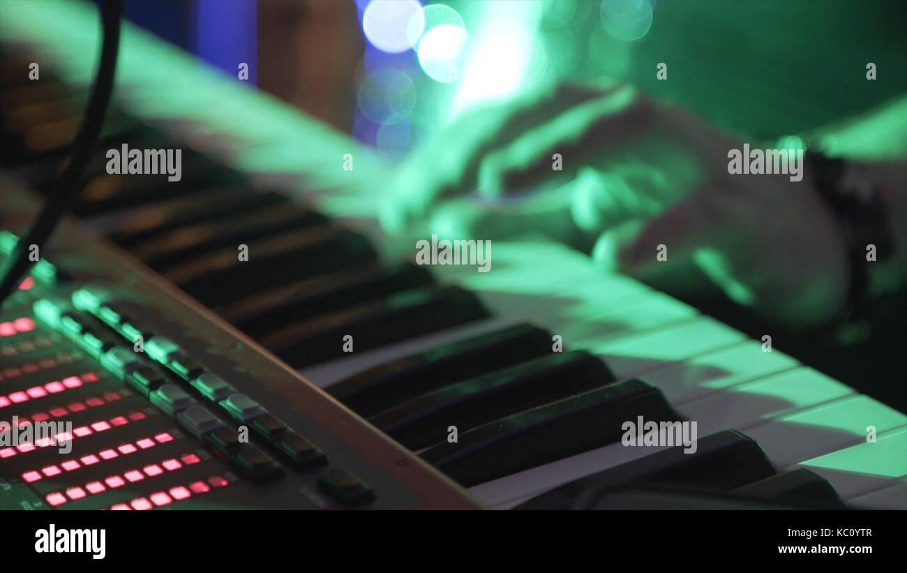 Closeup Of Male Hands Playing Piano. Man Playing The Synthesizer Keyboard. Man Plays Music Keyboard. Musician Plays - Stock Image