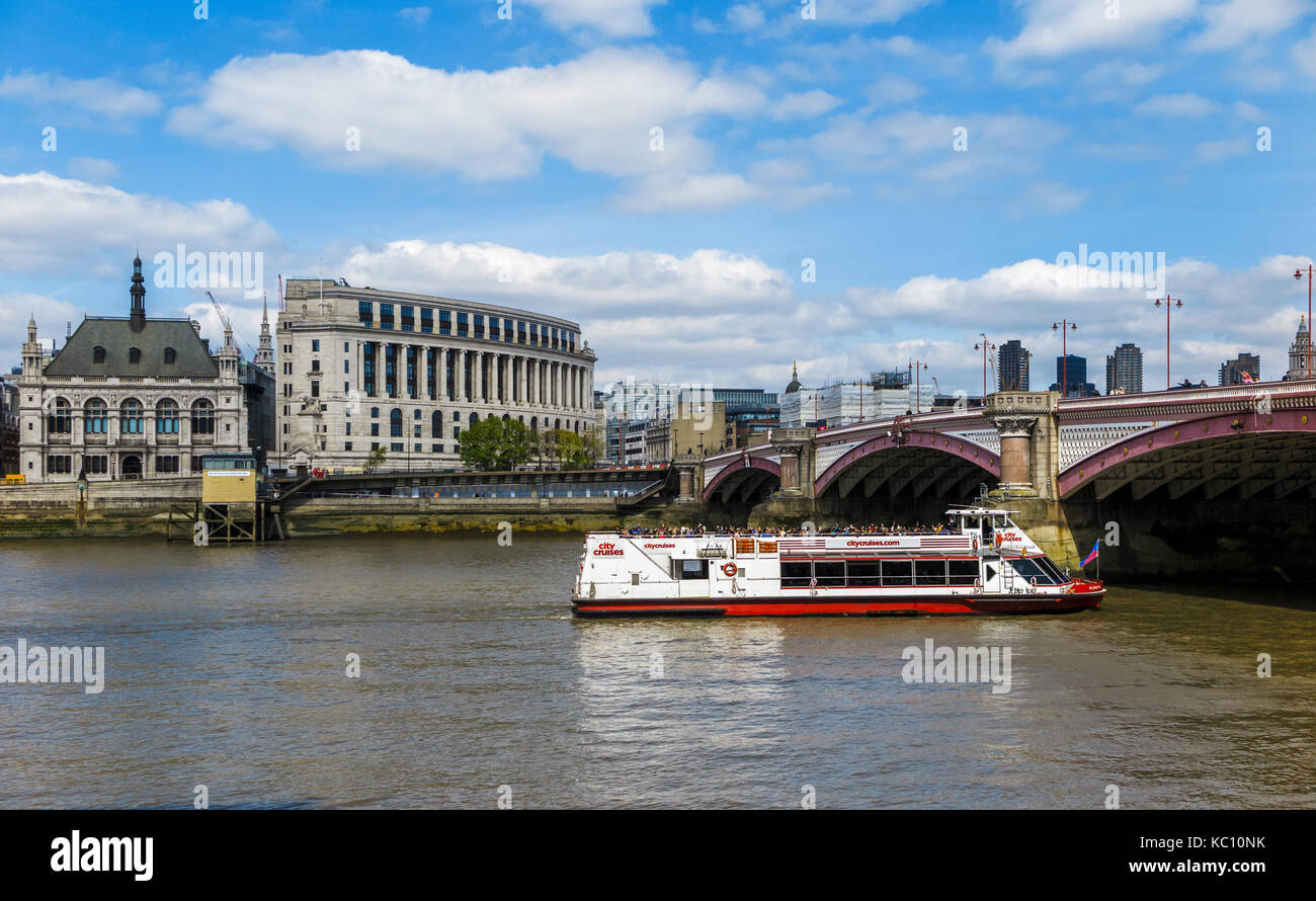 Red and white City Cruises tourist sightseeing boat on the River Thames sails under Blackfriars Bridge by Unilever - Stock Image